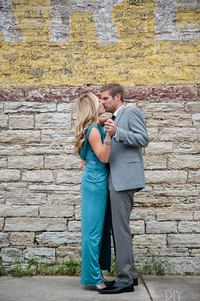 Dancing and kissing with glam engagement photos