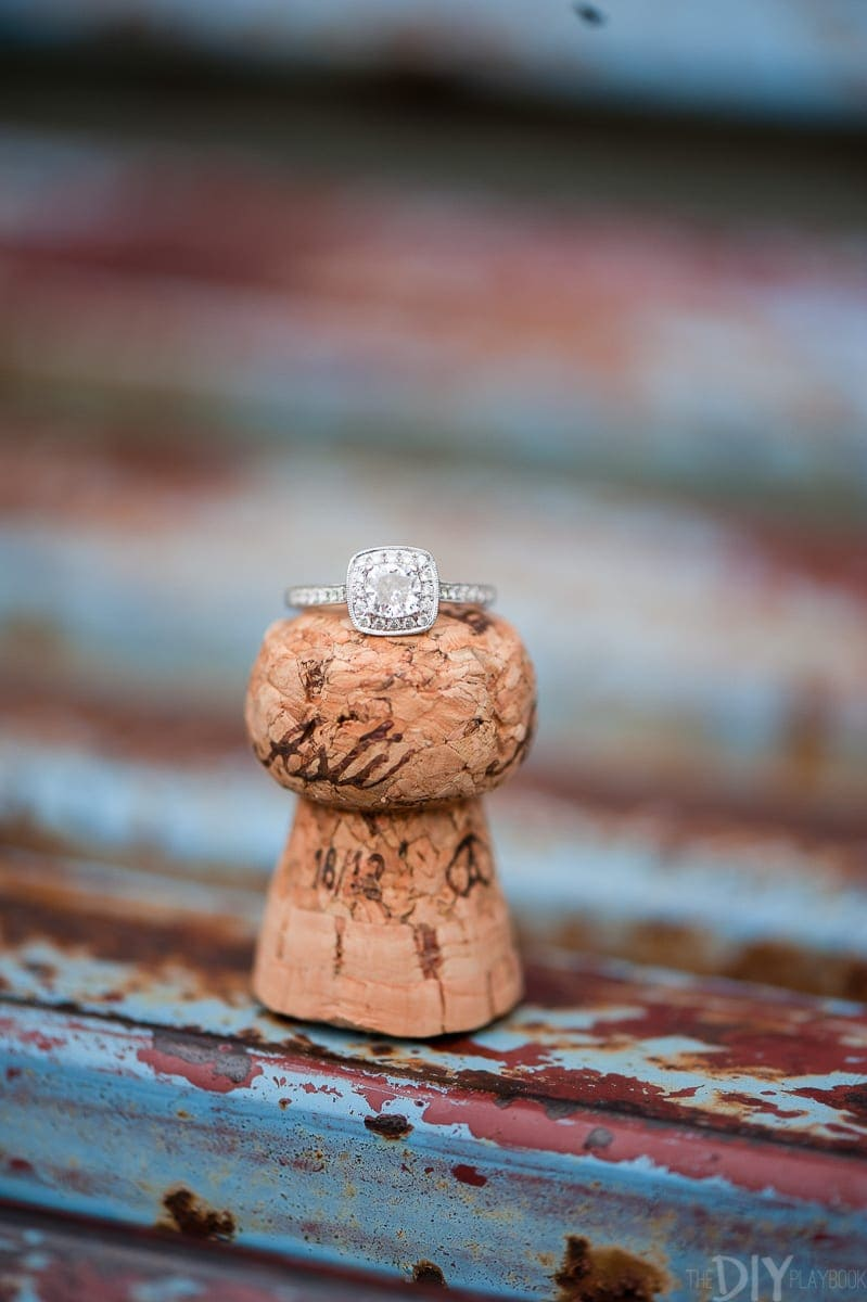 An engagement ring on a champagne cork