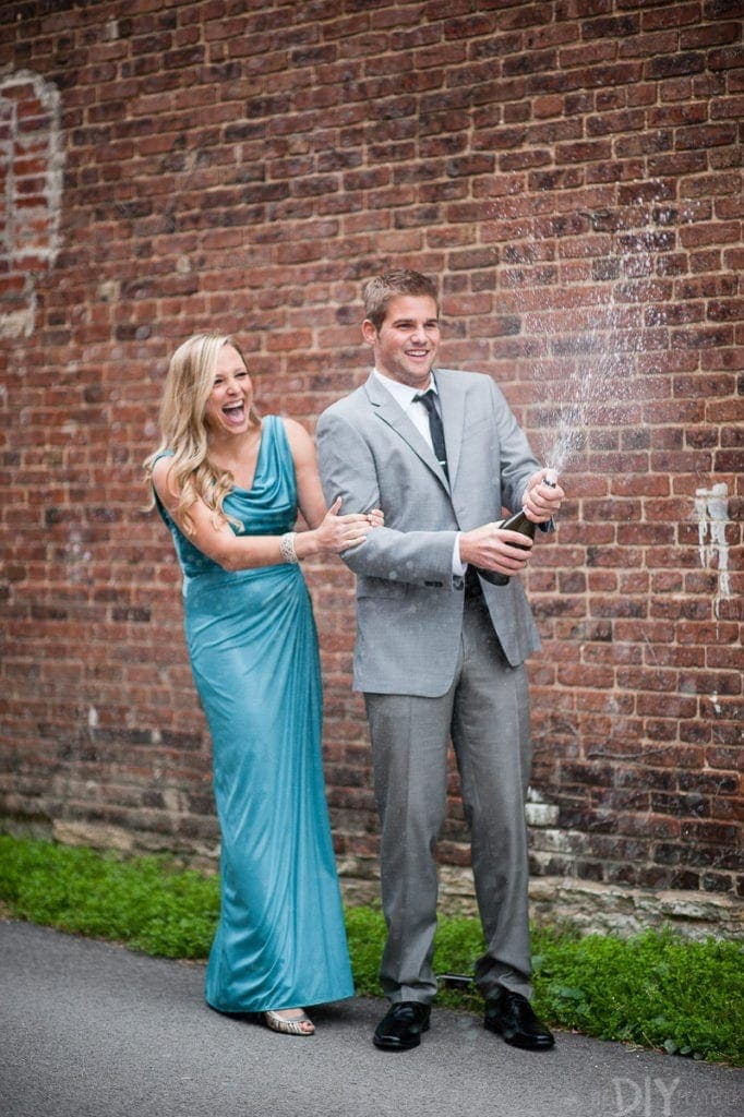 Spraying champagne engagement photos