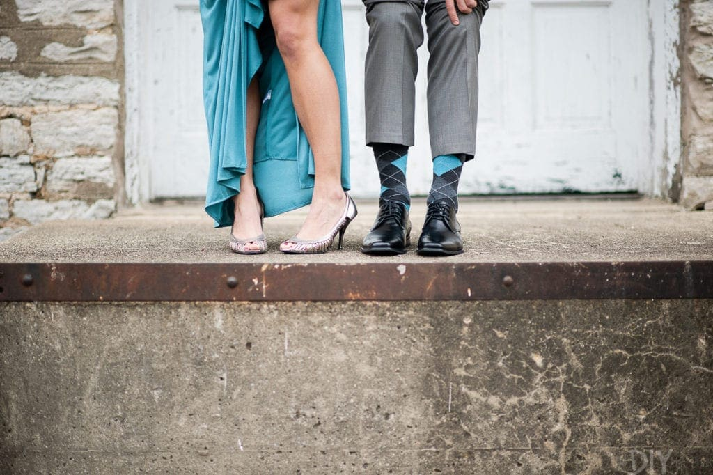 Showing off shoes in DIY engagement photos