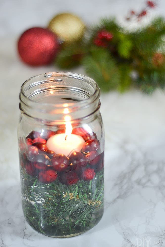 The Christmas candle mason jar holder will add a touch of holiday cheer to any room.