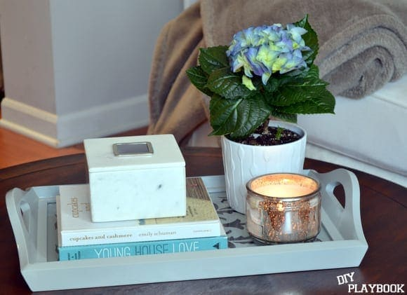 A cute tray is a great way to decorate a coffee table.