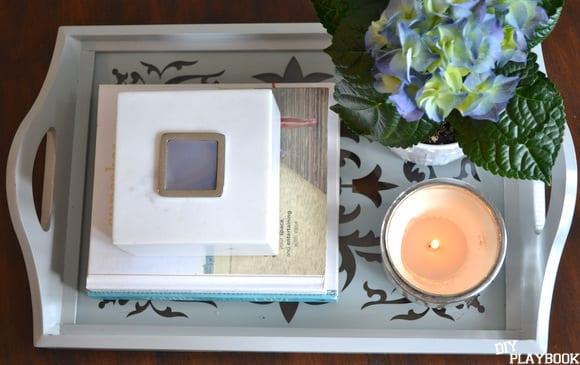 This grey coffee table tray is great for books, candles, or fresh flowers.