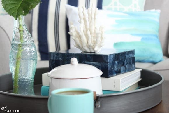 Pretty vases, books, and boxes add decorative elements to the coffee table.