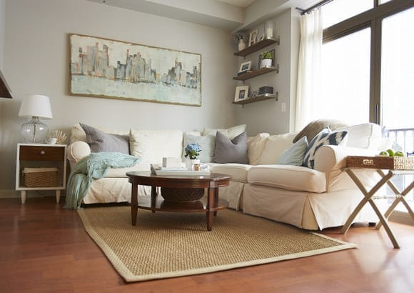 This decorated coffee table pairs well with the design of the living room.