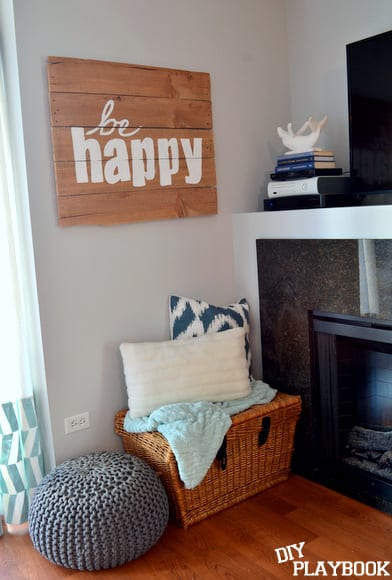 DIY Be Happy pallet sign hanging on the living room wall