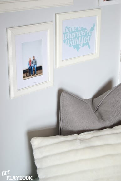 The neutral picture frames pop against the gray walls.