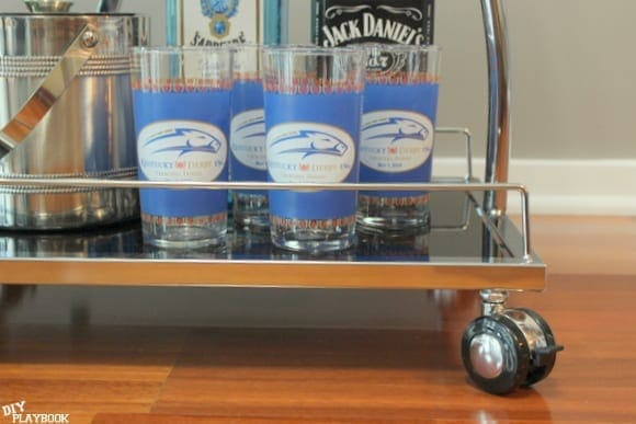The cups on this bar cart are unique.
