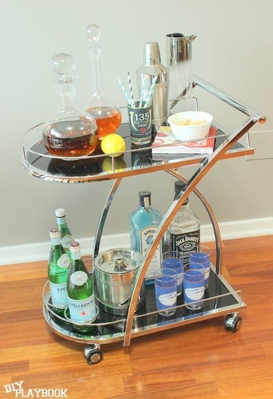 This one of a kind bar cart is decorated with lots of alcohol.