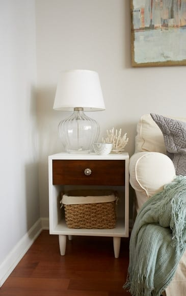 This two tone nightstand pairs well with the wood floors.
