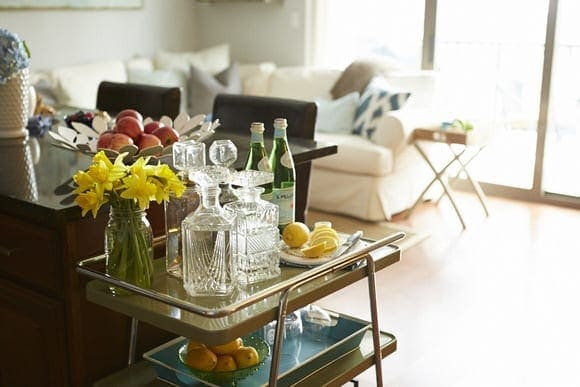 A sophisticated bar cart like this adds elegance to the living room.