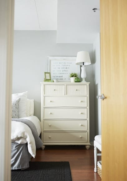 This white bedroom dresser pairs well with the gray duvet.