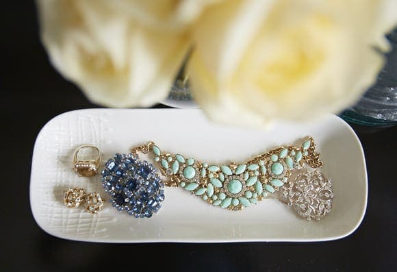 This white dish is perfect for keeping jewelry.