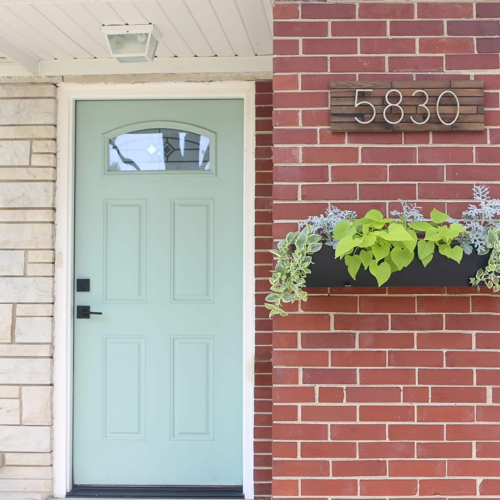 Choosing a front door paint color like this Covington Blue.
