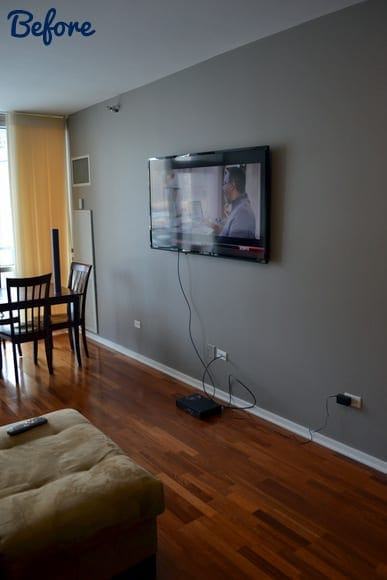 This masculine apartment has messy TV cords.