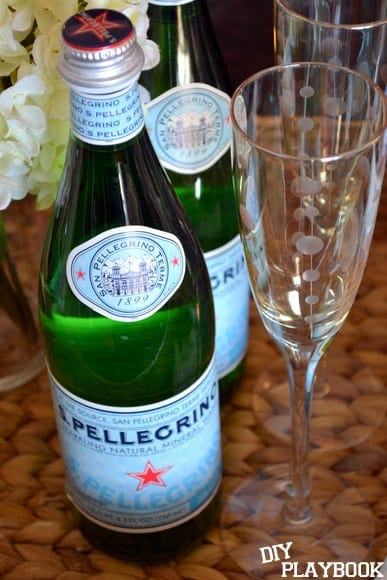 The wicker basket above the fridge holds champagne glasses and Pellegrino - perfect for setting the dinner table with! | DIY Playbook