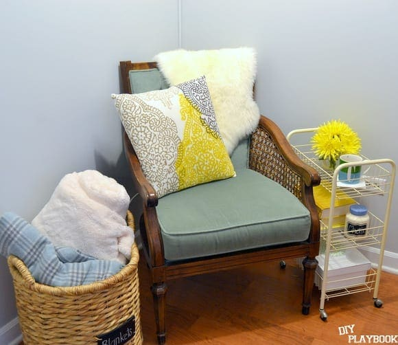 This classic wooden chair pairs well with the vibrant, modern throw pillow.