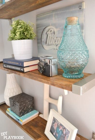 The blue vase on a shelf is the perfect place to store change.