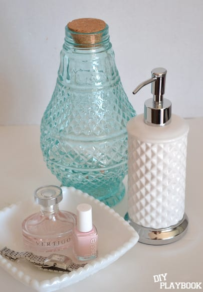 Pairing your blue vase with bath salts next to your soap dispenser or perfume is ideal.