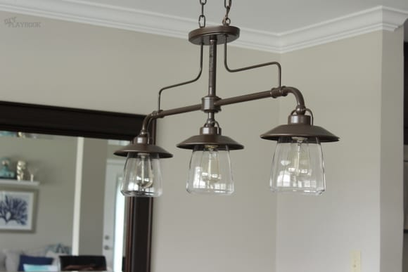 Our new dining room lights might be my favorite industrial lighting option. I love the three-lights-in-one!