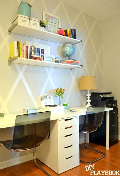 Every office needs a DIY diamond accent wall done with wide duct tape. I love how the white taping matches our white shelving and furniture too!
