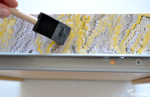Gluing wrapping paper