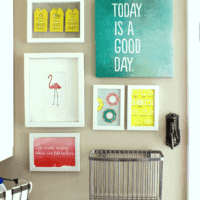This diverse gallery adds interest to the laundry room's decor.