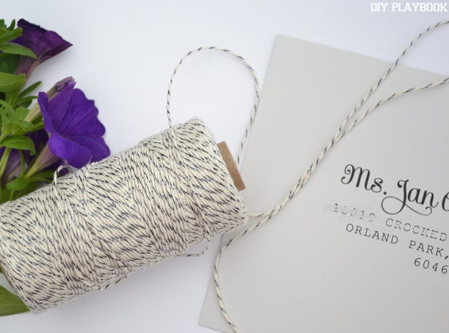 The RSVP cards were tied together with a white and gray twine