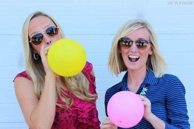 Casey and Bridget have fun blowing up balloons.