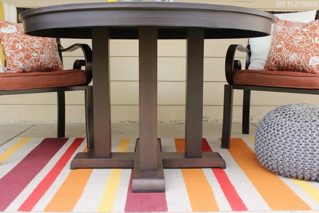This dark stained patio table is functional and chic.