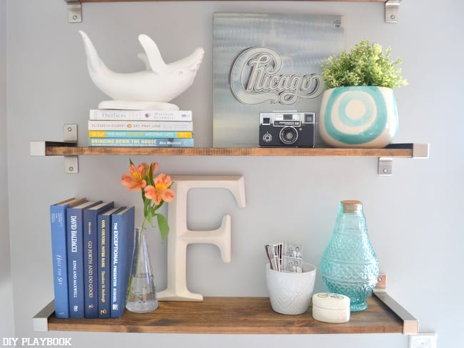 "Two of the three shelves I got from Ikea. You can see the ""F"" for Finn, our white wale, our Chicago record and a few other accessories we love."