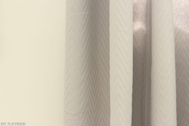The simple chevron pattern on these curtains is subtle and sweet