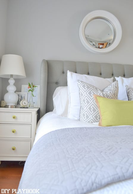 This lime green accent pillow on the bed adds a pop of color.