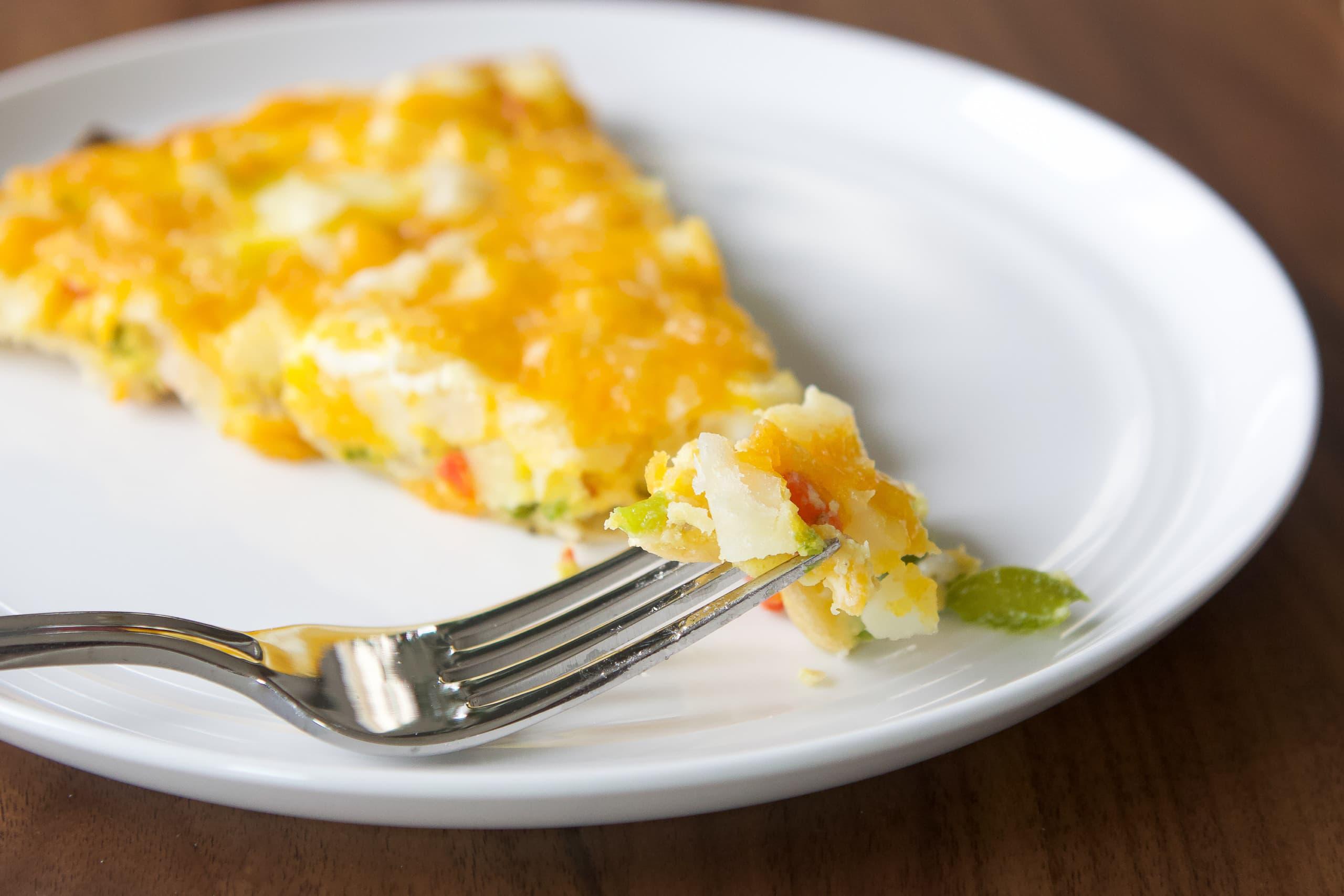 How to make cheesy breakfast pizza