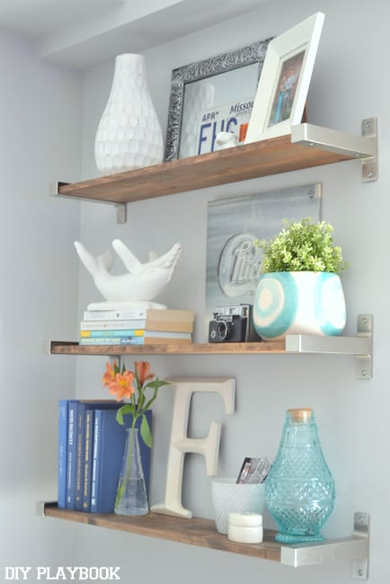 When installing shelves, always use odd numbers instead of even. I went for three shelves here and I love the look.