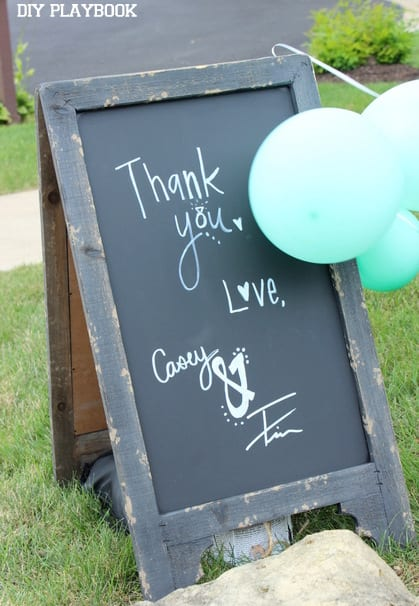 This chalkboard sign with a thank you from the bride and groom is adorable.