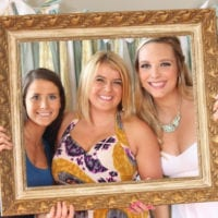 Casey poses with friends at her bridal shower photo booth.