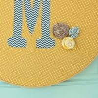 The monogrammed wall decor is cute and adds color.