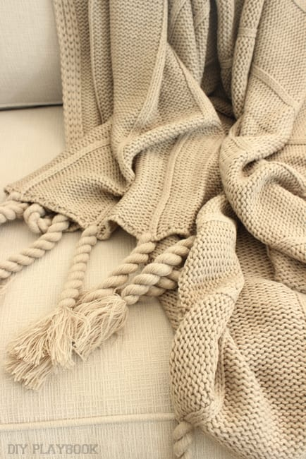 This tan throw blanket is cozy and looks great with the couch.