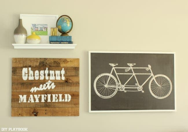 This wood and bicycle signs above the couch add a vintage design element.