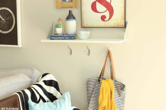 Small hooks near the entryway of the home are great for hanging bags.