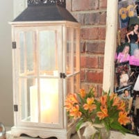 This cute white lantern with a candle adds a rustic element to the bridal shower.