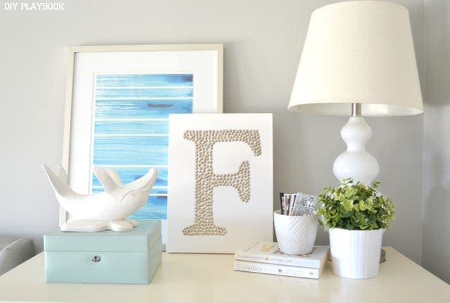 Here is the DIY thumbtack are on our end table! Doesn't it look great with the white wale?