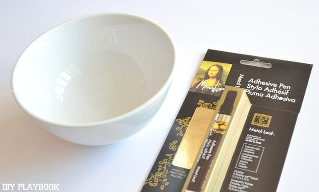 Assemble a white bowl and a gold leaf kit to start your DIY project.