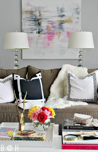 This decorate coffee table is chic with colorful roses and fashion books.