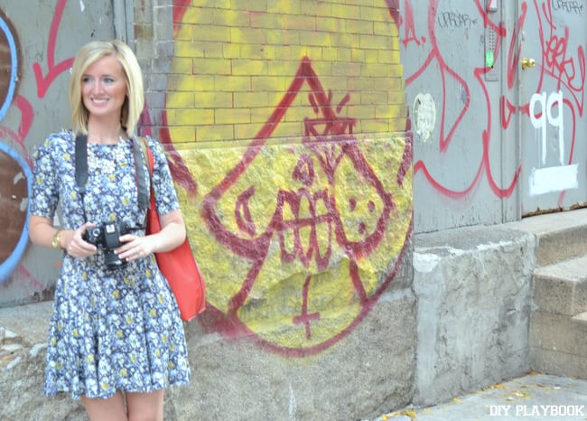 Bridget poses in front of the NYC graffiti wall.