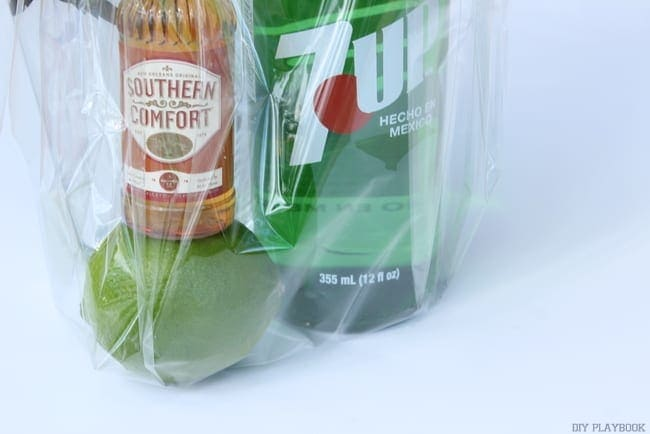 seven-up, soco and a lime make a great mini cocktail kit