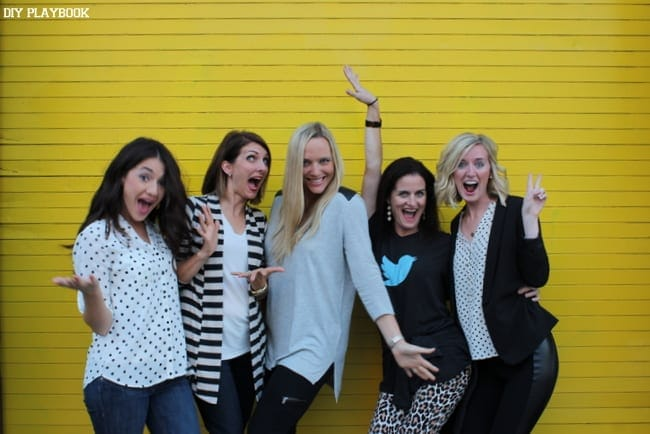 This group of bloggers took some funny pictures in front of a yellow wall.
