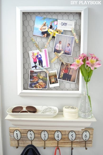 These shelves and hooks near the entryway are great for staying organized.