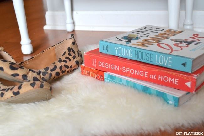 These books and leopard shoes on the faux fur rug add to the room's ambiance.